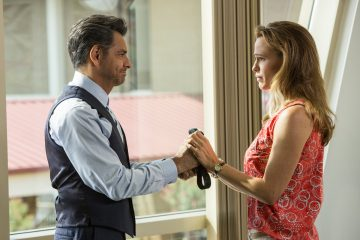 Dr. Nurkoo (EUGENIO DERBEZ) hands his Elmo tie to Christy (JENNIFER GARNER) as a memento now that Anna seems to be healed in Columbia Pictures'  HEAVEN IS FOR REAL.
